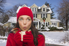 Woman in Winter Clothing Holding Mug Outside in Snow Royalty Free Stock Images