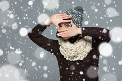 Woman in winter clothing making a frame with her hands Royalty Free Stock Photo