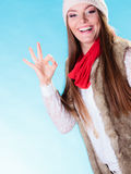 Woman in winter clothing ok gesture Royalty Free Stock Image