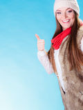 Woman in winter clothing ok gesture Royalty Free Stock Images