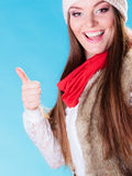 Woman in winter clothing ok gesture Stock Photography