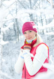 Woman in winter clothing outdoors Stock Images