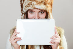 Woman in winter clothing with tablet Royalty Free Stock Images