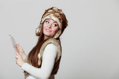 Woman in winter clothing with tablet Royalty Free Stock Image