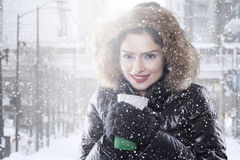 Woman with winter coat enjoy coffee Stock Images