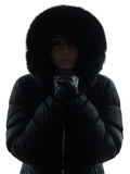 Woman winter coat freezing cold silhouette Royalty Free Stock Image