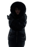 Woman winter coat freezing cold silhouette Royalty Free Stock Photo