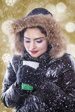 Woman with winter coat and holds hot coffee Royalty Free Stock Photo