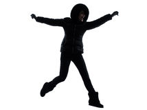 Woman winter coat jumping happy silhouette Stock Photo