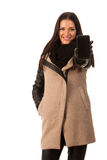 Woman in winter coat standing confidently, showing screen of cel Royalty Free Stock Images