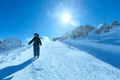 Woman on winter Dachstein mountain massif Stock Photography