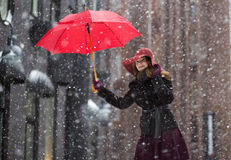Woman at winter day with red umbrella Royalty Free Stock Photo