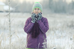 Woman in winter field Royalty Free Stock Photo