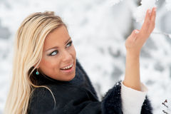 Woman in winter forest Royalty Free Stock Photos