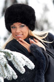 Woman in winter forest Stock Photo