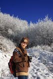 Woman in winter forest Royalty Free Stock Photography