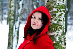 Woman in winter forest Royalty Free Stock Images