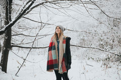 Woman in winter forest Stock Photography