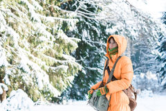 Woman in winter forest Stock Photos