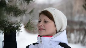 Woman in winter forest near a pine stock video