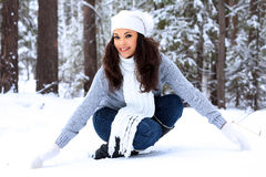 Woman in a winter forest Royalty Free Stock Images