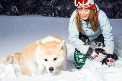 Woman and winter fun with dog Royalty Free Stock Photography