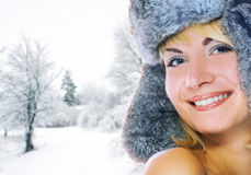 Woman in winter fur-cap Stock Photography