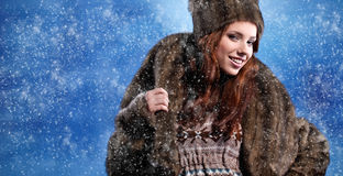 Woman in winter fur coat Stock Image