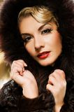 Woman in winter fur coat Royalty Free Stock Images