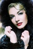Woman in winter fur coat. Beautiful woman in winter fur coat. Toned in blue Royalty Free Stock Images