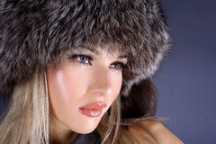 Woman in winter fur hat Royalty Free Stock Images
