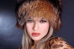 Woman in winter fur hat Royalty Free Stock Photos