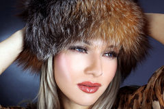 Woman in winter fur hat Stock Photography