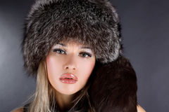 Woman in winter fur hat Stock Image