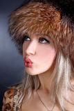 Woman in winter fur hat Stock Photos
