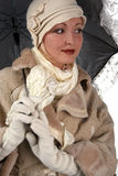 Woman in winter fur with umbrella Royalty Free Stock Photography