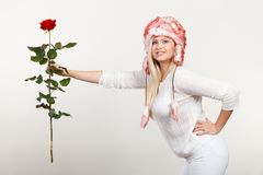 Woman in winter furry hat holding red rose Stock Images