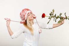 Woman in winter furry hat holding red rose Royalty Free Stock Photography