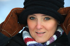 Woman in winter with hat. Girl in snow. She is wearing a nice hat Royalty Free Stock Photography