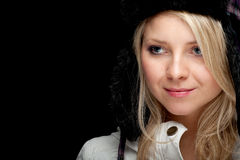 Woman in winter hat and bright coat Stock Photos