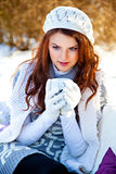 Woman in winter hat with cup of hot tea Stock Photography
