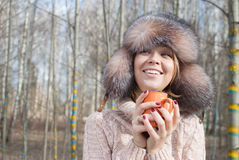 Woman winter hat drink tea. Woman in fur russian hat drinking hot tea in forest Royalty Free Stock Photos