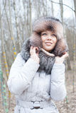 Woman winter hat. Woman in forest cold in fur hat Stock Images