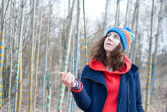 Woman winter hat. Woman in winter in forest colored tree sream Stock Photography