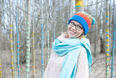 Woman winter hat. In forest in glasses Royalty Free Stock Image
