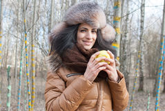 Woman winter hat holding apple Stock Photos