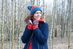 Woman winter hat. Woman in russian hat in forest Stock Photo