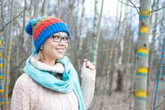 Woman winter hat. Woman in russian hat in forest in glasses Stock Photography