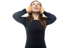 Woman with winter headphones Royalty Free Stock Images