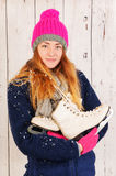 Woman in winter with ice skates Royalty Free Stock Photos